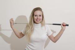 Girl holding golf club Royalty Free Stock Photos