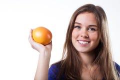 Girl holding grapefruit Royalty Free Stock Photos