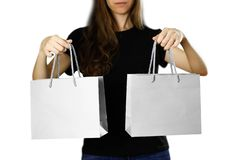 Girl holding a gray paper gift bag. Close up. Isolated background royalty free stock photos