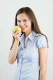 Girl holding a green apple Stock Photos
