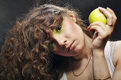 Girl holding a green apple Stock Image