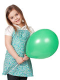 Girl holding a green balloon Royalty Free Stock Images