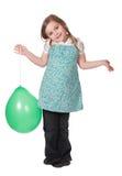 Girl holding a green balloon Stock Photo