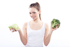 Girl holding a green cabbage and broccoli stock photo