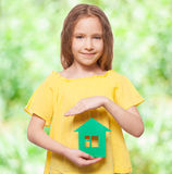Girl holding a green house Stock Photo