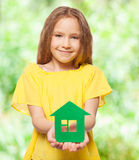 Girl holding a green house Stock Image