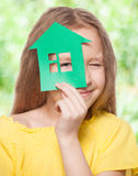 Girl holding a green house Stock Photos