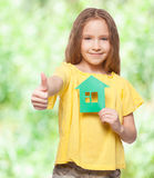 Girl holding a green house Royalty Free Stock Photography