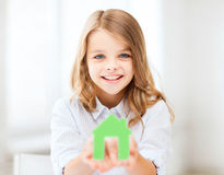 Girl holding green paper house Stock Photography