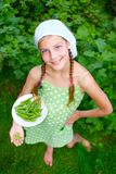 Girl holding a green Peas Royalty Free Stock Photography