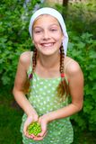 Girl holding a green Peas Stock Image