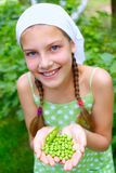 Girl holding a green Peas Stock Photography