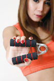 Girl holding gripper in her hand. Stock Images