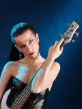 Girl holding a guitar Stock Photos