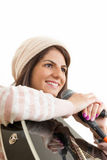 Girl holding guitar and microphone. Girl with cap dressed in sweater holding guitar and microphone Royalty Free Stock Images