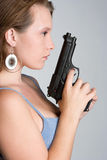 Girl Holding Gun Stock Photo