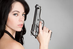 Girl Holding Gun Royalty Free Stock Image