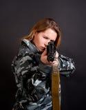 Girl holding gun Stock Photos