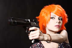 Girl holding gun Stock Photography
