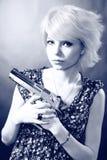 Girl holding gun Royalty Free Stock Images