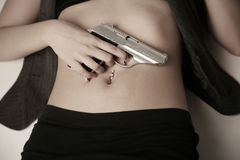 Girl holding a gun Royalty Free Stock Image