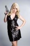 Girl Holding Gun. Pretty blond girl holding gun stock images