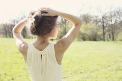 Girl holding hair Royalty Free Stock Image