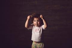 Girl Holding Hair Stock Images