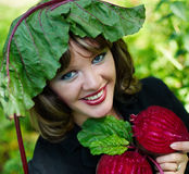 Girl holding half beets Royalty Free Stock Image