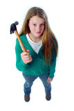 Girl holding a hammer. A young girl holding a hammer Stock Photography