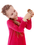 Girl holding a hamster Stock Photo