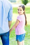 Girl holding hand of father Stock Image