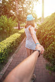 Girl holding a hand man on the street Royalty Free Stock Image