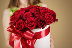 Girl holding in hand rich gift bouquet of 21 red roses. Composit Stock Image