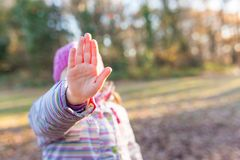 Girl holding hand up saying stop royalty free stock image