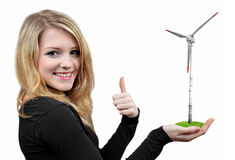 Girl holding in hand wind turbine. On white Stock Photography