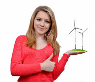 Girl holding in hand wind turbines Royalty Free Stock Photography