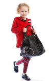 Girl holding a handbag Stock Photo