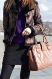 Girl holding a handbag. Girl is holding a bag on hands stock photos