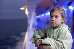 Girl holding on handrails on large ship Stock Photo
