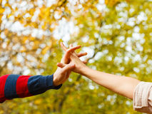 Girl holding hands with boy. Love romance dating outdoor woodland scenery concept. Girl holding hands with boy. Young lady and men showing feelings affection in Stock Photography