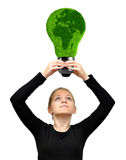 Girl holding in hands eco energy bulb. On white background Stock Photography
