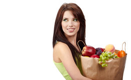 Girl holding in hands full of different fruits Stock Photography