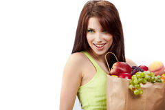 Girl holding in hands full of different fruits Stock Images