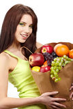 Girl holding in hands full of different fruits Stock Image