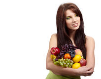 Girl holding in hands full of different fruits Royalty Free Stock Image