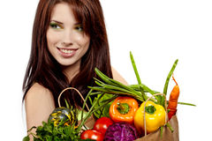 Girl holding in hands full of different fruits Stock Photos