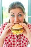 Girl holding hands a hamburger Royalty Free Stock Photos
