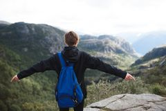 Girl Holding Hands Up. On top of mountain Stock Images