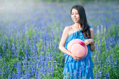 Girl holding hat in lavender Stock Images